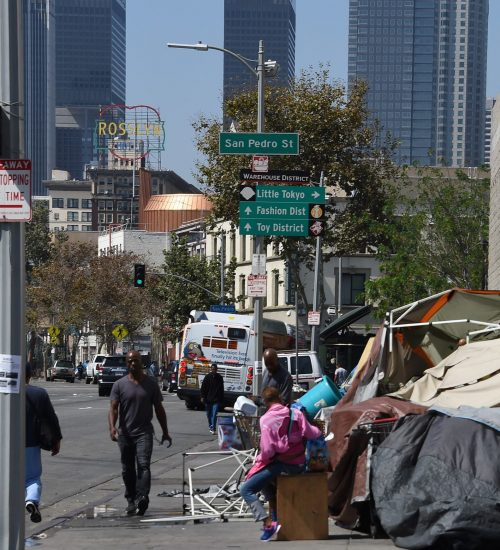 Los Angeles financial district skyscrapers are seen behind a homeless tent encampment, September 23, 2015 in downtown Los Angeles.  Los Angeles officials declared the homeless situation a public emergency. making Los Angeles the first city in the nation to take such a drastic step in response to its mounting problem with street dwellers.  AFP PHOTO / ROBYN BECK        (Photo credit should read ROBYN BECK/AFP/Getty Images)